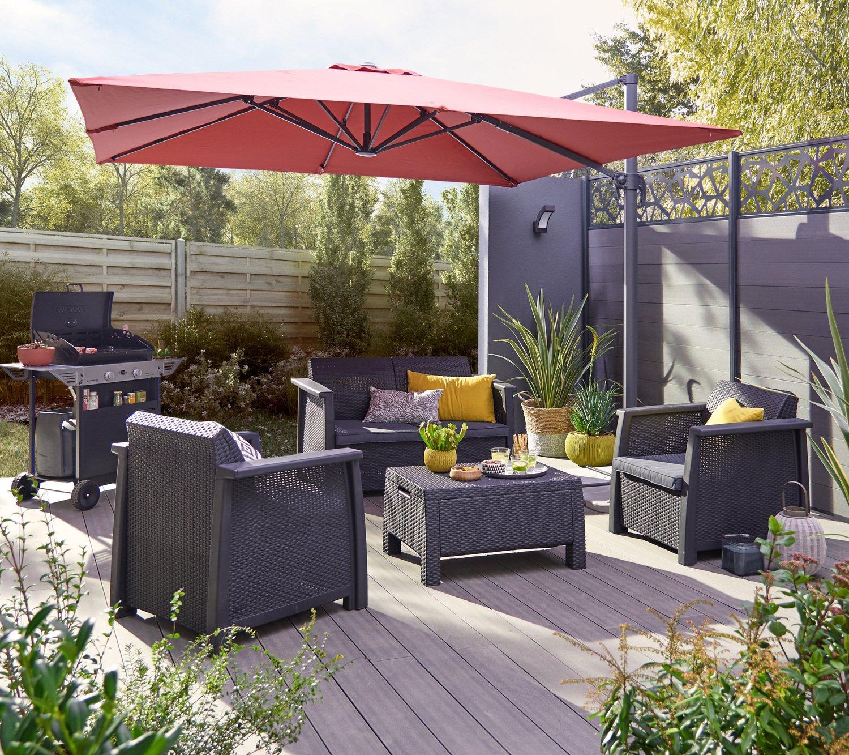 Un espace d tente contemporain avec un salon bas de jardin en r sine inject e gris leroy merlin for Salon jardin contemporain