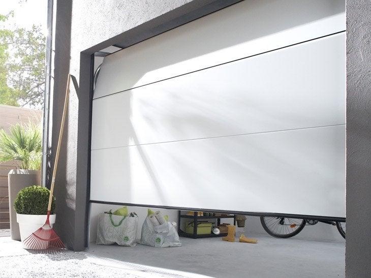 Portes de garage sur mesure sous haute surveillance - Porte de garage sectionnelle motorisee leroy merlin ...