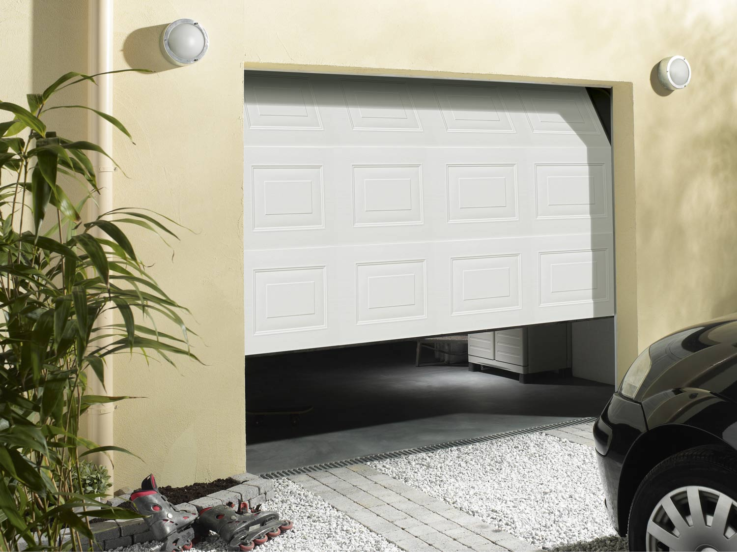 Comment poser une porte de garage sectionnelle leroy for Installation porte de garage enroulable