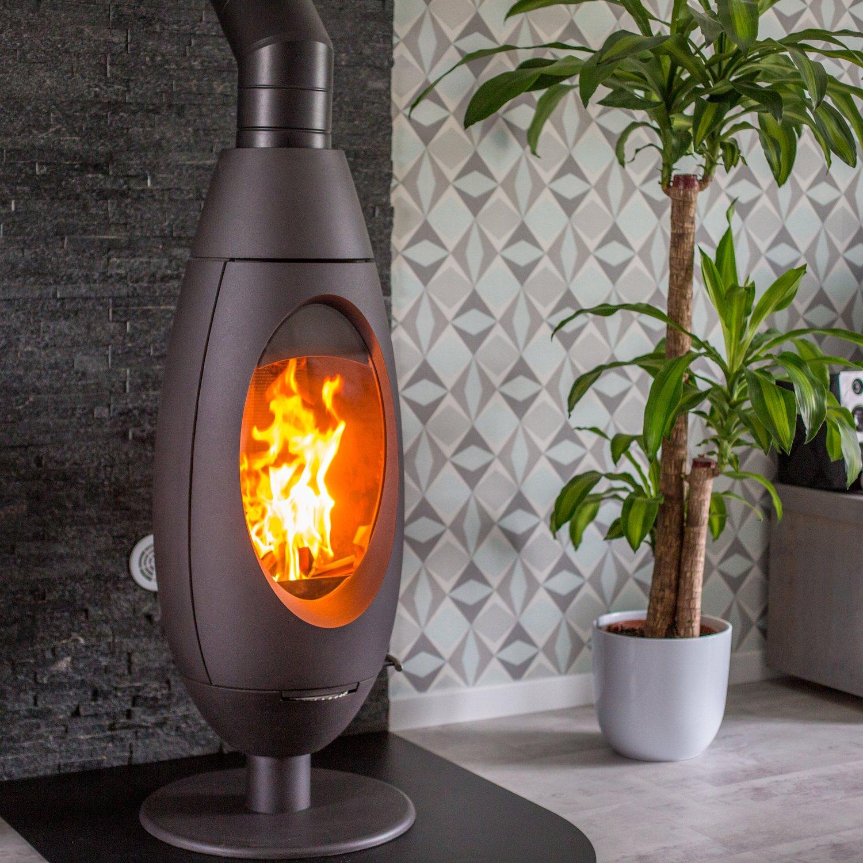 zoom sur le po le bois dans le salon de david roucourt leroy merlin. Black Bedroom Furniture Sets. Home Design Ideas