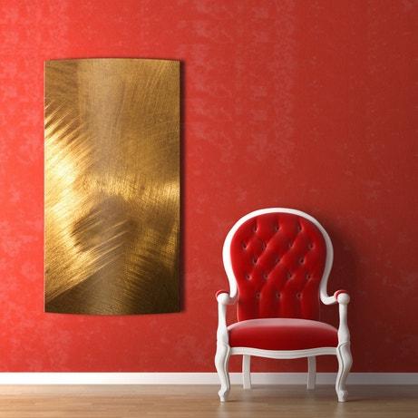 Un radiateur électrique à l'effet cuivre brossé pour chauffer et décorer votre salon