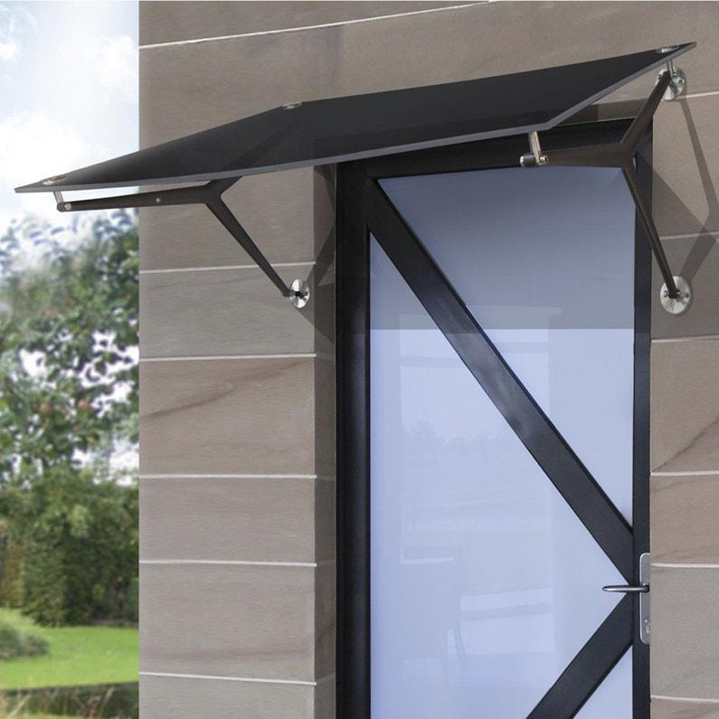 un auvent en verre noir assorti la porte d 39 entr e. Black Bedroom Furniture Sets. Home Design Ideas