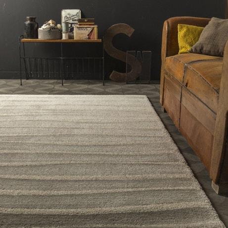 Un tapis beige cosy pour le salon