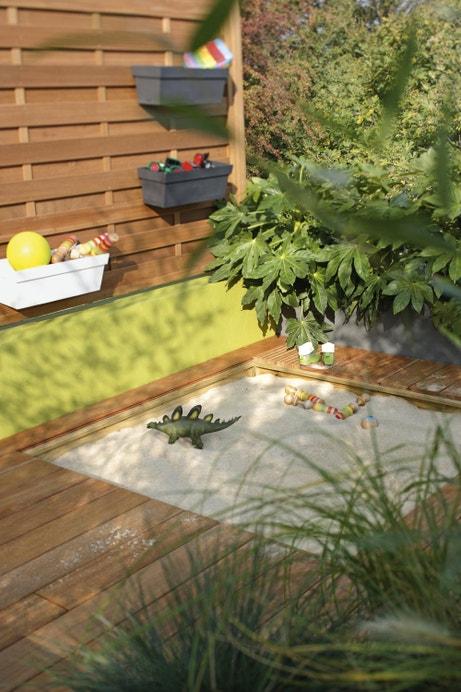 Un bac à sable pour enfants qui s'adapte à la terrasse