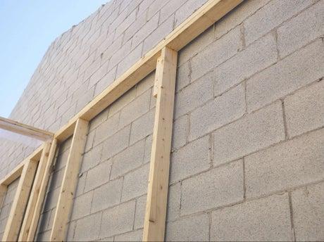 Comment construire un mur en parpaings coller leroy merlin - Comment recouvrir un mur en parpaing ...