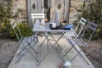 une table de jardin ronde en acier pour votre terrasse leroy merlin. Black Bedroom Furniture Sets. Home Design Ideas
