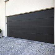Pose d'une porte de garage sectionnelle motorisée de 200x300 cm par Leroy Merlin