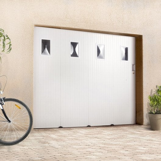 Pose d 39 une porte de garage coulissante lat rale leroy merlin for Porte de garage enroulable pose sous linteau