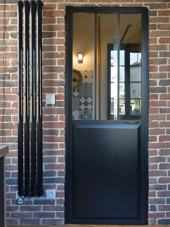 La porte et le radiateur au style industriel leroy merlin for Porte de garage style atelier