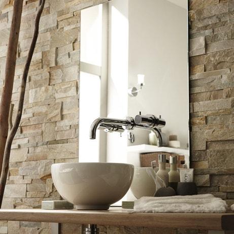 Une vasque à poser et des plaquettes de parement pour une salle de bains zen et nature