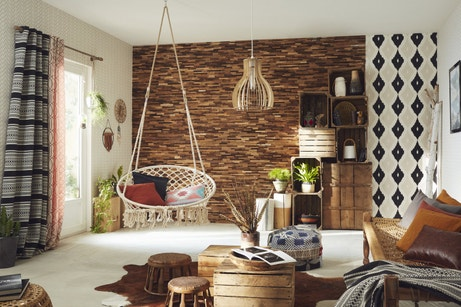Des matières naturelles et une palette de bruns et ocres pour un salon au style ethnique