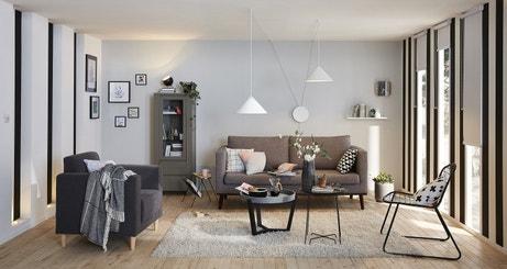 Jouer sur la hauteur sous plafond pour un séjour design et contemporain