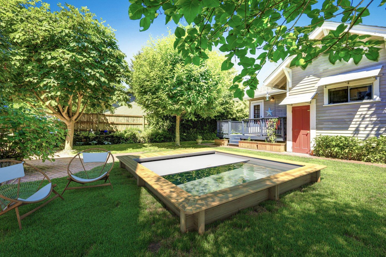 Une piscine hors sol bois de forme rectangulaire leroy - Amenagement exterieur piscine hors sol ...